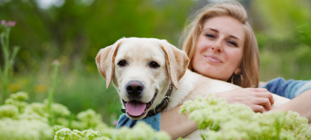 bigstock-Girl-with-her-dog-posing-in-sp-121322931